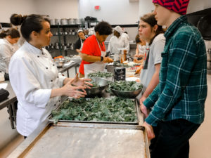 Roadstead students learning to prepare food with a culinary chef